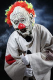 Scary monster clown. With hammer Stock Image