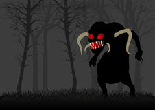 Scary Monster In Dark Woods. Silhouette illustration of a scary monster with red eyes in dark woods Stock Photo
