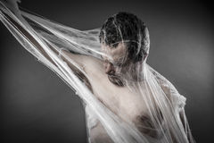 Scary network.man tangled in huge white spider web Royalty Free Stock Images