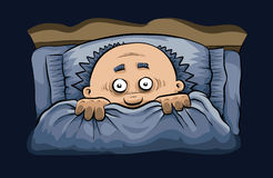 Scary Night in Bed. A cartoon man cowers under the covers in bed at night Stock Image
