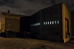 Scary night city Chicago alley next to an urban warehouse Stock Photography
