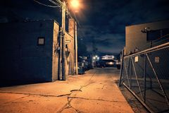 Scary night city Chicago alley next to an urban warehouse Royalty Free Stock Image