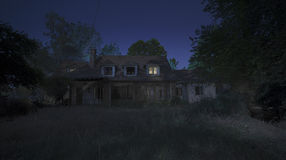 Scary night. A dark dusk embraces an old house Stock Photography