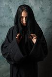 Scary nun in a cape. Scary nun in a black cape Royalty Free Stock Photos