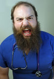 Scary Nurse. An angry scary nurse growls at the camera Royalty Free Stock Photo