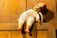 Scary old, broken doll. Stock Photography