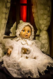 Scary old, broken doll. Royalty Free Stock Images