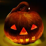 A scary old lantern on black, pumpkin. Stock Photography