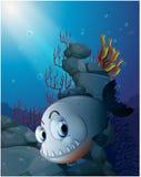 A scary piranha near the rocks. Illustration of a scary piranha near the rocks on a white background Stock Photos
