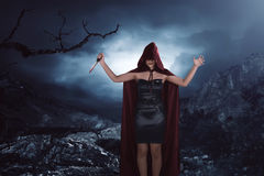 Scary portrait of an asian witch woman covering his face holding Royalty Free Stock Photo