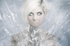 Scary Psychedelic Woman Face. Scary girl face with white eyes and no mouth Royalty Free Stock Photo