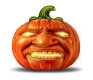 Scary Pumpkin. Jack o lantern with an angry devil like realistic human expression on the orange halloween holiday symbol with magical glowing candle light on a Stock Photos