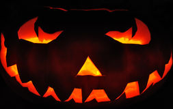 Scary pumpkin. Authentic carved pumpkin for Halloween lit from inside with candles Royalty Free Stock Photos