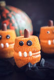 Scary pumpkin cup cakes. Halloween concept Stock Photo