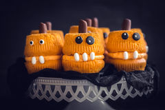 Scary pumpkin cup cakes. Scary cup cakes served,halloween decoration Stock Images