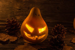Scary pumpkin with fiery eyes. stock photos