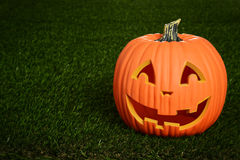 Scary pumpkin on grass Royalty Free Stock Photos