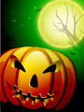 Scary pumpkin in the Halloween night background. Stock Images