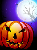 Scary pumpkin in the Halloween night background. Royalty Free Stock Photos