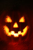 Scary pumpkin lighted in dark Royalty Free Stock Images