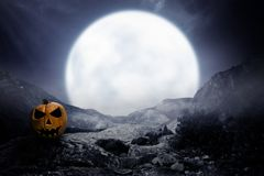 Scary pumpkin with moonlight stock photography
