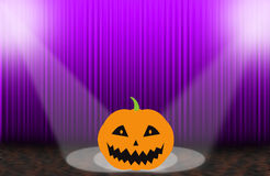 Scary pumpkins on the Purple rising curtain Royalty Free Stock Photography