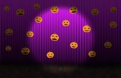 Scary pumpkins, Purple rising curtain with spotlight Stock Photos
