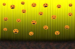 Scary pumpkins,Yellow rising curtain with spotlight Royalty Free Stock Photography