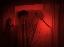 Scary Red Burglar Breaking In House Royalty Free Stock Photography