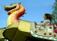Scary rollercoaster ride. Girl screaming during scary rollercoaster ride for children Royalty Free Stock Photography