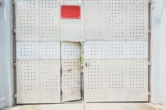 Scary rusty metal door with door locked Stock Image