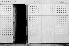 Scary rusty metal door with door locked Stock Photo