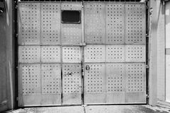 Scary rusty metal door with door locked Royalty Free Stock Photography