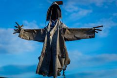 Scary scarecrow hooded stock photography