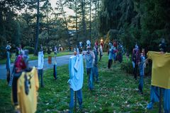 Scary Scarecrows. In Sleepy Hallow, NY the children embrace Halloween by making scary scarecrows placed throughout historic areas of the town Royalty Free Stock Images