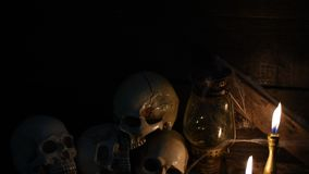 Halloween scene. Scary scene for Halloween with skull and candle stock video