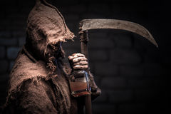 Scary scythman is waiting for every alcoholic Stock Image