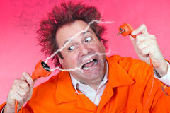 Scary serviceman. Serviceman is shocked from sparks from an electric plug connector royalty free stock photography