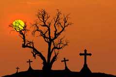 Scary silhouette dead tree and spooky silhouette crosses in mystic graveyard with half moon Stock Photos