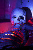 Scary Skeleton in Bathtub Close Up. Scary Skeleton in Bathtub with colored lighting Close Up Royalty Free Stock Images