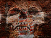 Scary skull. Halloween image of scary skull on grunge wall Stock Image