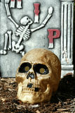 Scary skull with gravestone Stock Image