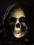 Scary skull head in black hood Royalty Free Stock Photo