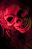 Scary Skull in Red Colored Light. Scary Halloween skull with hair in red colored lighting Royalty Free Stock Image