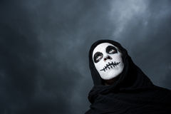 Scary skull woman cloudy skies Royalty Free Stock Photo