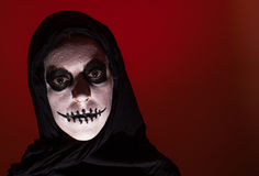 Scary skull woman red background Royalty Free Stock Images