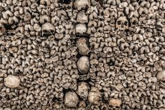 Paris: Circa May 2011: Scary Skulls and Bones in the Catacombs of Paris IV royalty free stock image