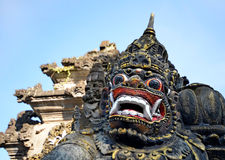 Scary stone barong mask at entrance to Tanah Lot, Bali Royalty Free Stock Image