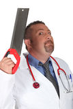 Scary surgeon. A scary surgeon holding saw Royalty Free Stock Image