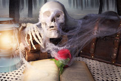 Scary table with a book Royalty Free Stock Images